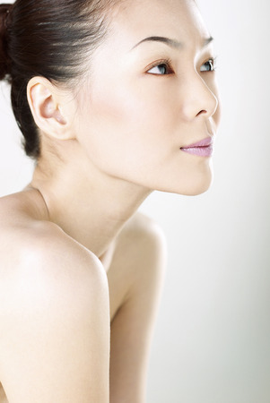 hair tied: Side shot of a lady with her hair tied up