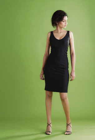 Studio shot of a short haired lady in black dress and high heels