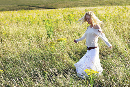 long skirt: A woman in long skirt running on the field