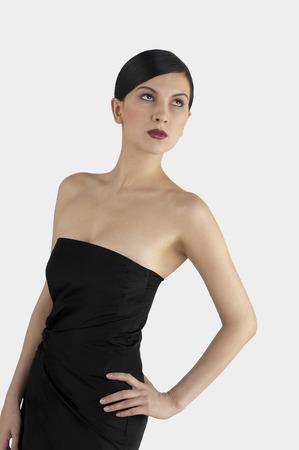 dinner wear: Studio shot of a lady in black dinner dress