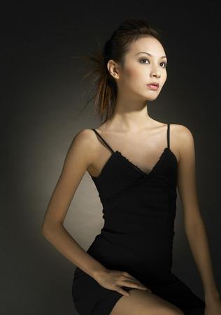 dinner wear: Studio shot of an elegant looking lady in black dress