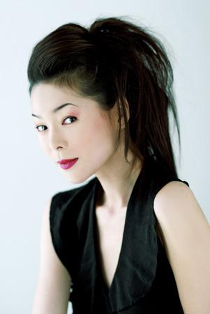Studio shot of a lady in black dress