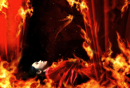 red bathrobe: Fire engulfing a sleeping woman in red bathrobe Stock Photo