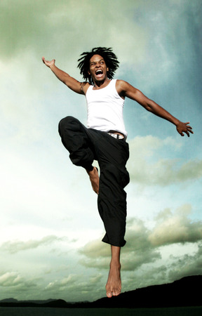A African American man jumping high up in the sky photo