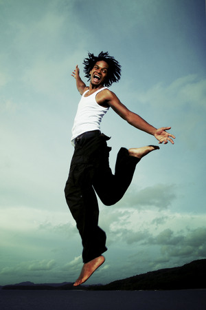 A African American man jumping high with his mouth wide opened