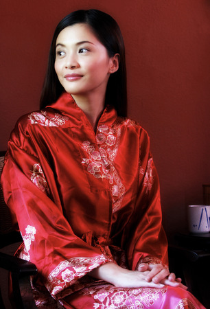 oriental bathrobe: A lady in oriental bathrobe smiling and looking away Stock Photo