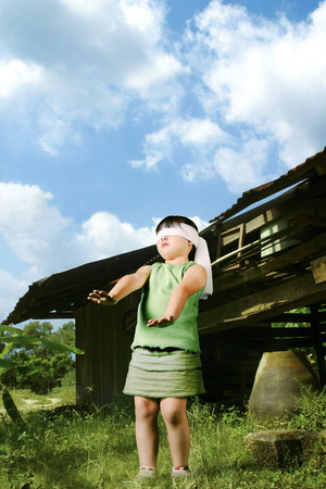 blindfolded: A blindfolded girl trying to find her way to escape