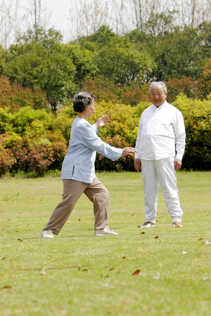 An old woman practising tai chi  photo