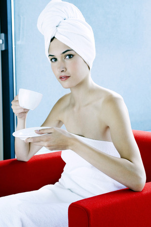 hair wrapped up: Woman wrapped in towel drinking a cup of coffee