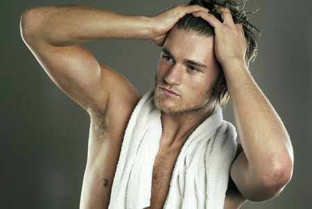 hair gel: Shirtless man applying gel on his hair