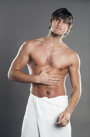 wrapped in a towel: Muscular man wrapped in towel