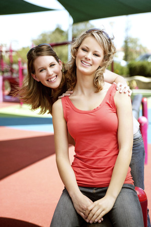 spaghetti strap: Two teenage girls having fun at the playground