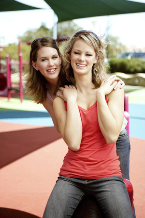 housemate: Two teenage girls having fun at the playground