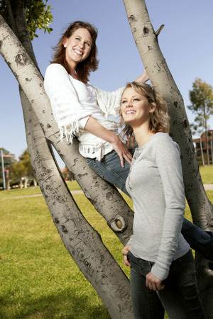 housemate: Two teenage girls smiling happily in front of the camera Stock Photo