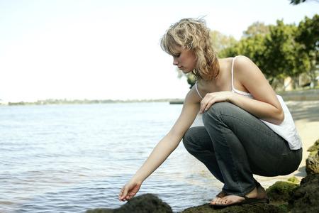 spaghetti strap: A teenage girl enjoying herself beside the lake Stock Photo