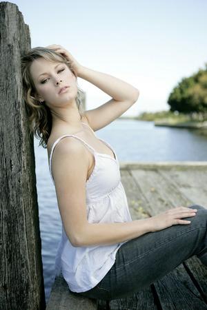 spaghetti strap: A teenage girl posing for the camera