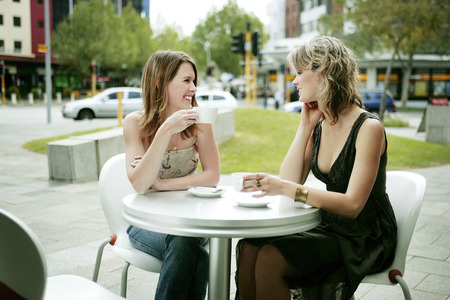chit chat: Two friends spending the evening leisurely in town