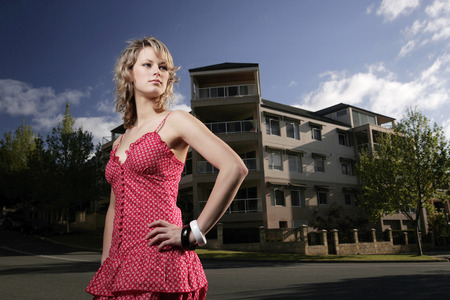 area sexy: A teenage girl posing in front of the apartment Stock Photo