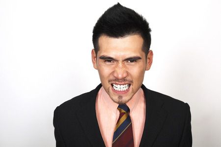 clenching teeth: Angry businessman clenching teeth