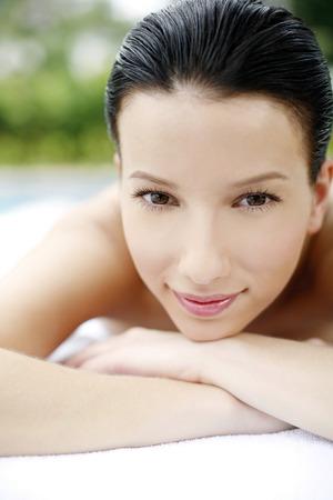 lying forward: Woman lying forward on massage table