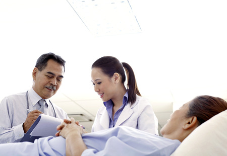 professionalism: Doctors checking on patient