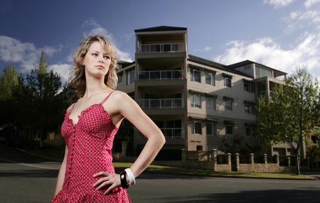 spaghetti strap: A teenage girl posing in front of the apartment Stock Photo