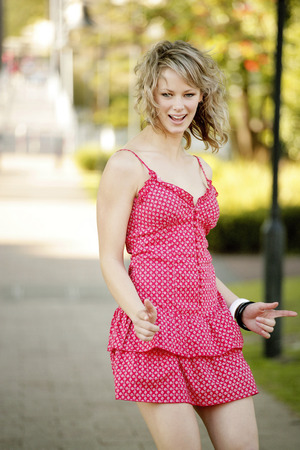 spaghetti strap: An energetic young teenage girl in pink dress