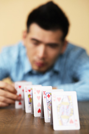 Businessman arranging playing cards photo