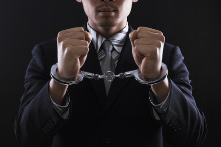 Businessman in handcuffs photo