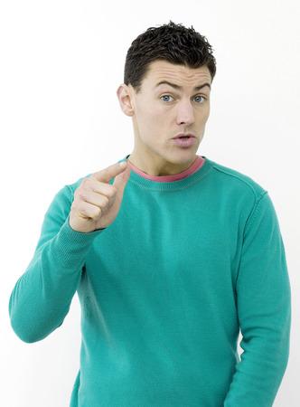 Angry man pointing at camera Stock Photo