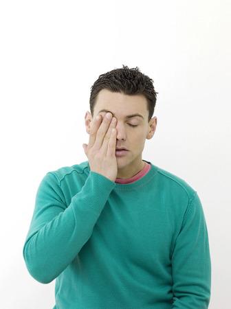 wearied: Man feeling sleepy