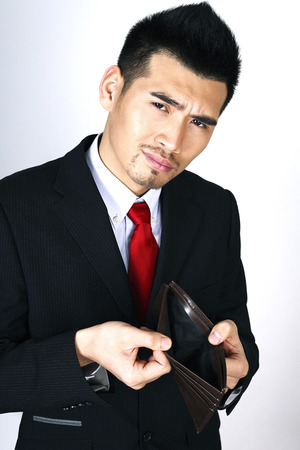 Businessman showing his empty wallet photo