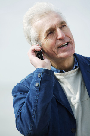 verbal communication: A man talking on the phone