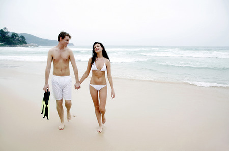 Couple taking a stroll along the beach photo