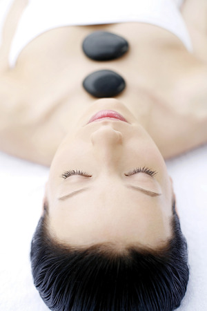 lastone therapy: Woman enjoying a relaxing lastone therapy