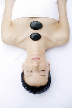 Woman enjoying a relaxing lastone therapy photo