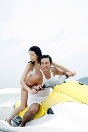 Couple riding jet ski photo