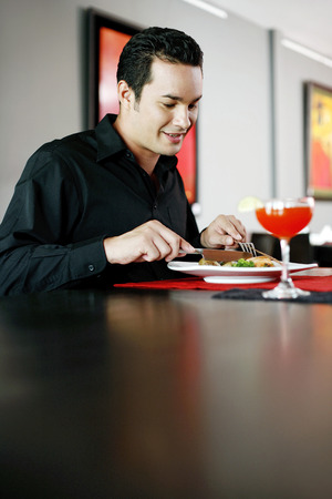 Man enjoying his meal in a luxurious restaurant photo