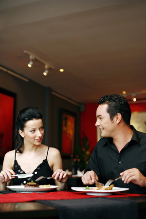 Couple enjoying their meal in a luxurious restaurant photo