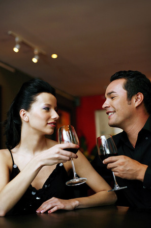 Couple drinking wine together photo