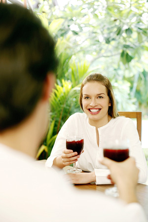 Couple enjoying red wine in the garden photo