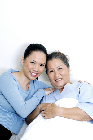 healthcare visitor: Patient with her daughter Stock Photo