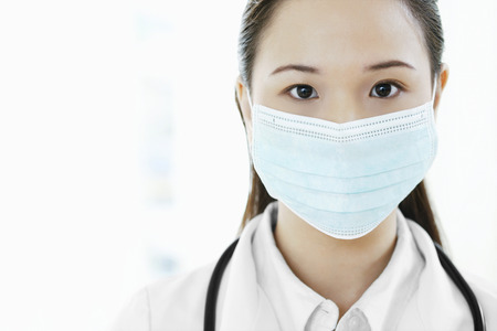 Female doctor with surgical mask