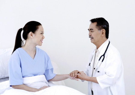 recovering: A recovering patient talking to doctor Stock Photo