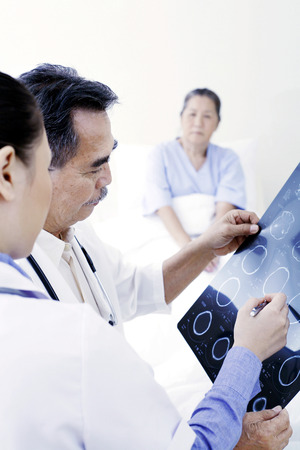 Doctors discussing about an x-ray photo