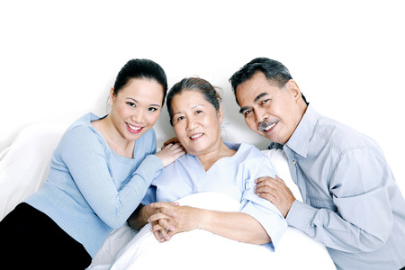 recovering: Patient with her family Stock Photo