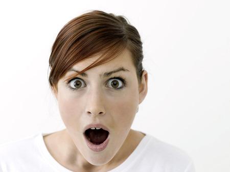 facial gestures: Mujer en estado de shock Foto de archivo