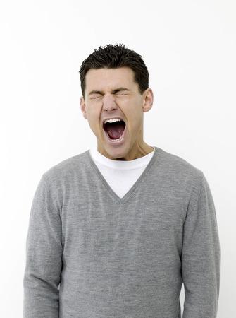 wearied: Sleepy man yawning Stock Photo