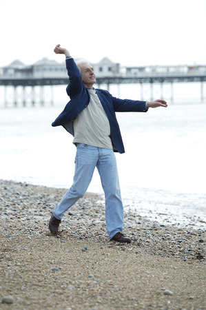 A man throwing a stone into the sea