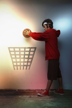 seriousness skill: Man putting basketball into hoop symbol